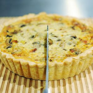 Pioneer Woman's Quiche With Peppered Bacon, Butter, Onions, White Mushrooms, Artichoke Hearts, Pie Crust, Eggs, Heavy Cream, Swiss Cheese, Salt, Pepper, Fresh Chives, Fresh Parsley