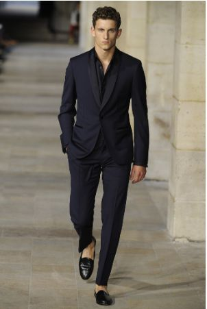 5b584b1c494 Skip the black suit, and go with a navy ensemble. This gives you a slightly  laid back look that black does not allow. Forget the tie.