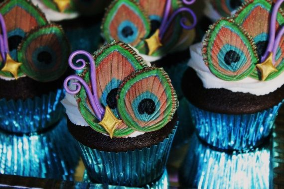 Edible peacock feather cupcakes!     @Hannah Wood    although I think I am going to make feathers like this for the owl icecream.