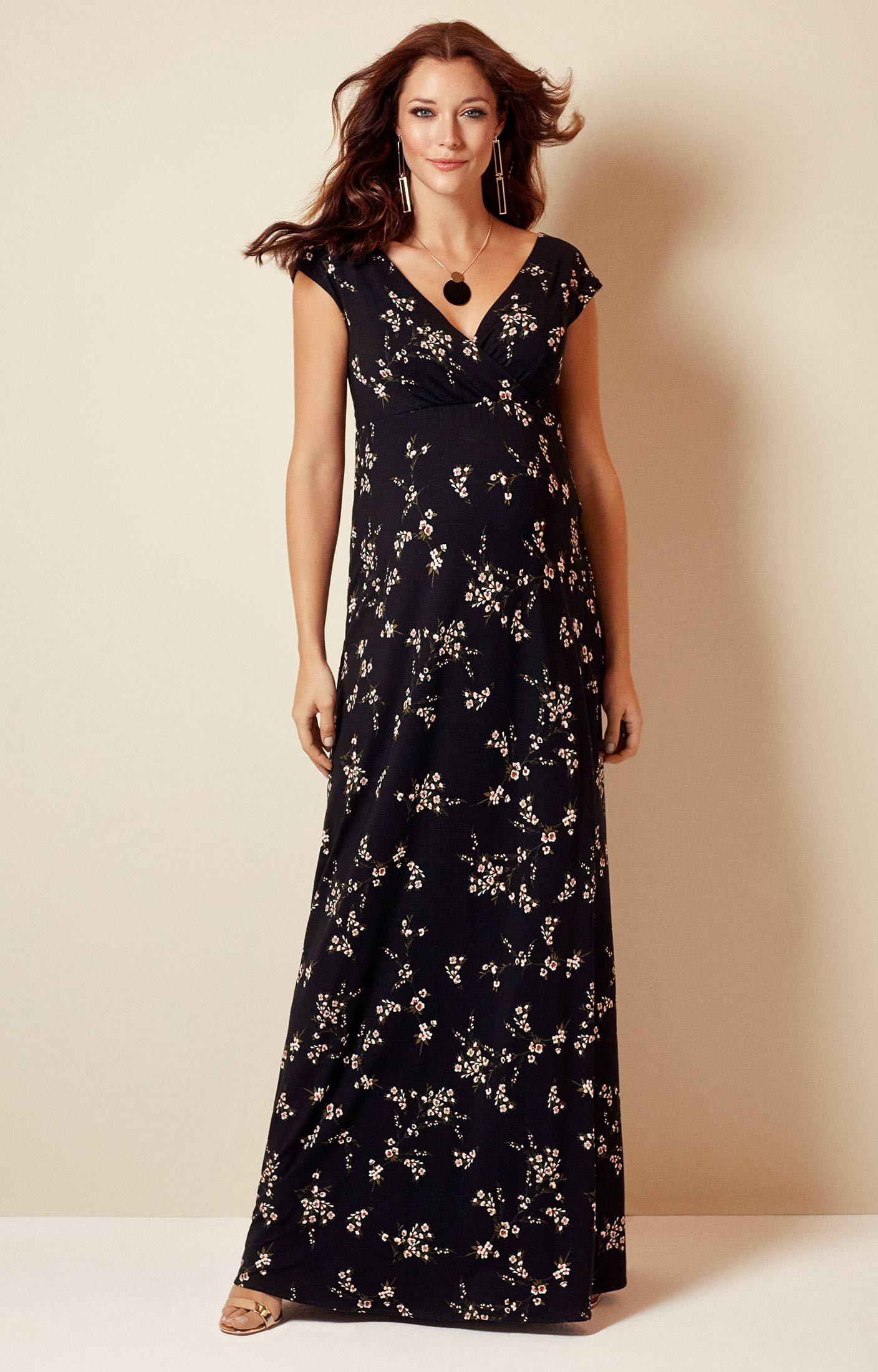 a9d7047fd754f With a hint of oriental charm, our Alana maternity maxi dress has a  beautiful blossom print that is striking against a jet black backdrop.