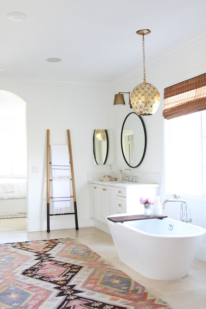 Modern Bohemian Master Bath Retreat   Crisp White With The Metallic  Fixtures And Textured Rugs Are A Perfect Mix Of Casual And Elegance