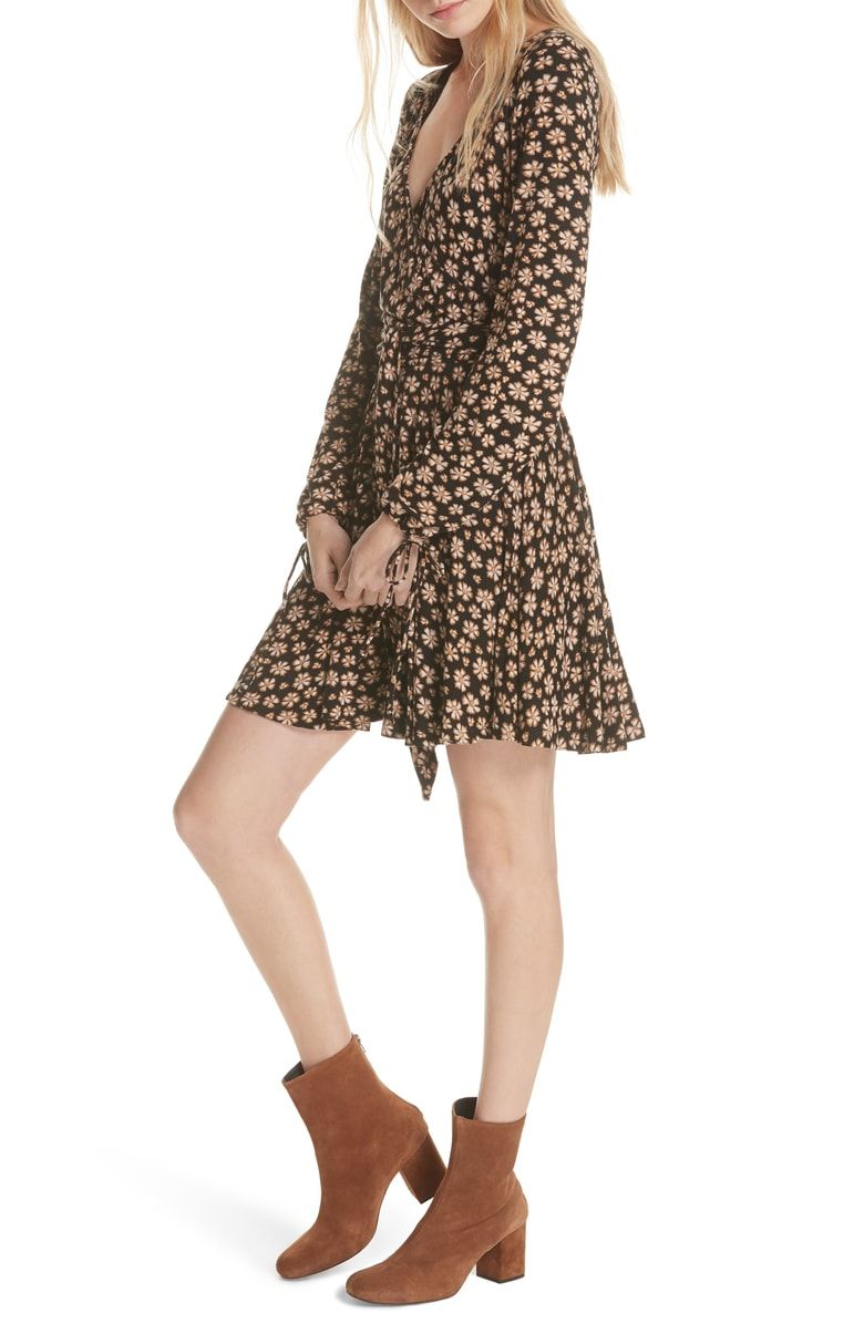 97beb16c84a2 Free shipping and returns on Free People Pradera Floral Minidress at  Nordstrom.com. Blossoms and bows bring that boho vibe to a flowing mini  with a flirty ...