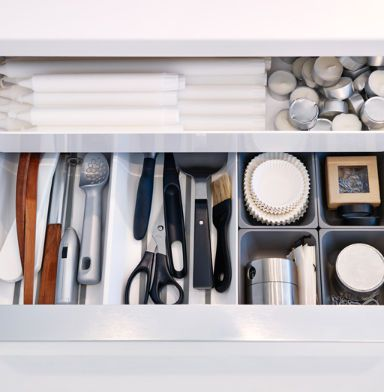 Close-up of open IKEA drawer with boxes, mats and trays keeping ...