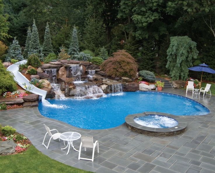 Residential Pool With Waterfalls And White Curved Water Slide On Rock Combined Residential Pool Swimming Pool Designs Small Swimming Pools