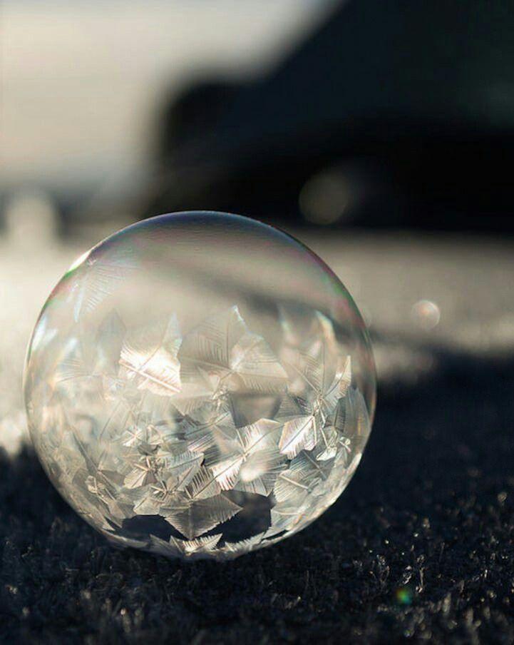 Not glass. Frozen air bubble.