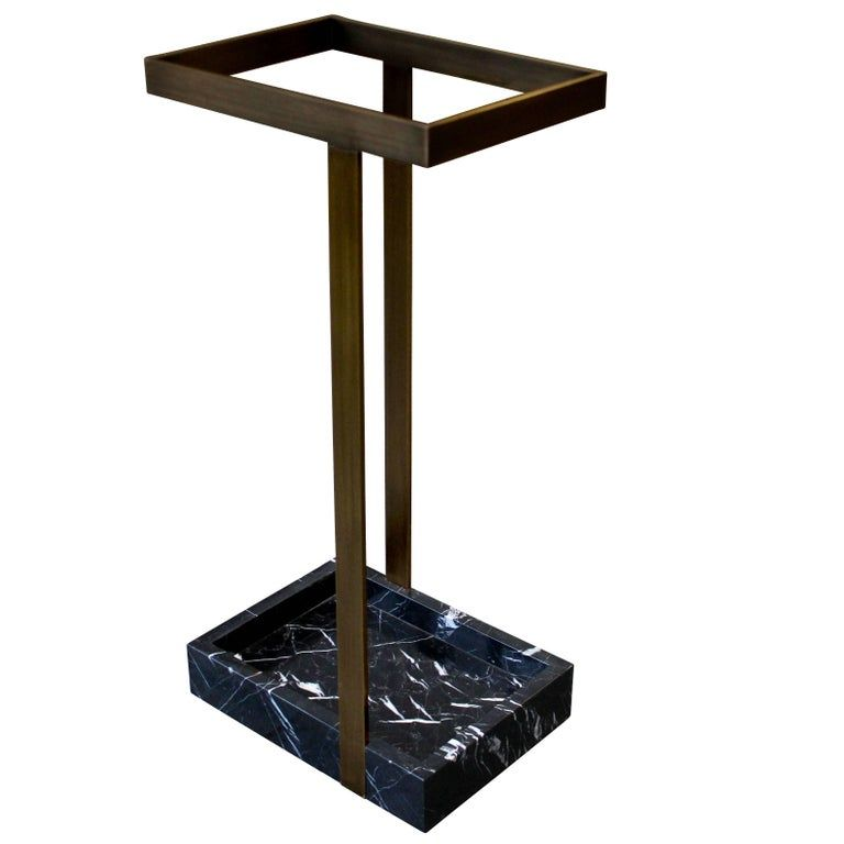 This subtle yet striking umbrella stand creates an arresting focal point to a foyer or vestibule. Shown here in patinated bronze with nero marquina marble, the piece is handmade to order in New York City and can be specified in any number of custom sizes, finishes, and materials.