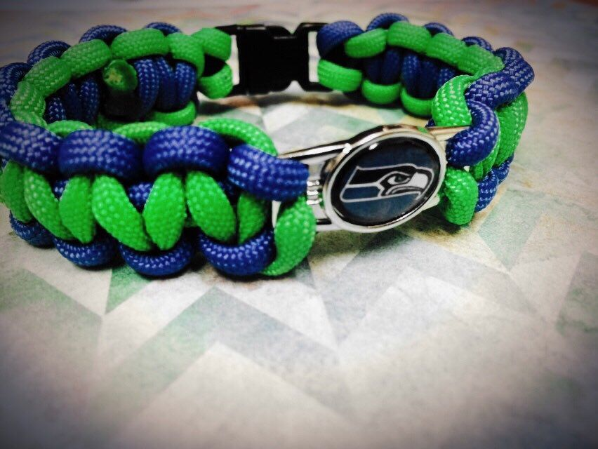 A personal favorite from my Etsy shop https://www.etsy.com/listing/242373575/paracord-bracelet-seahawks-charm