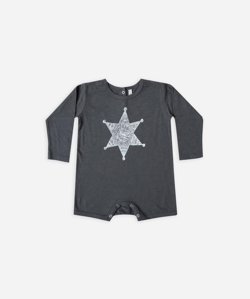 26e2115c742e Baby dash romper with  sheriff star  graphic. Snaps along inseam and back  of neck for easy changing.