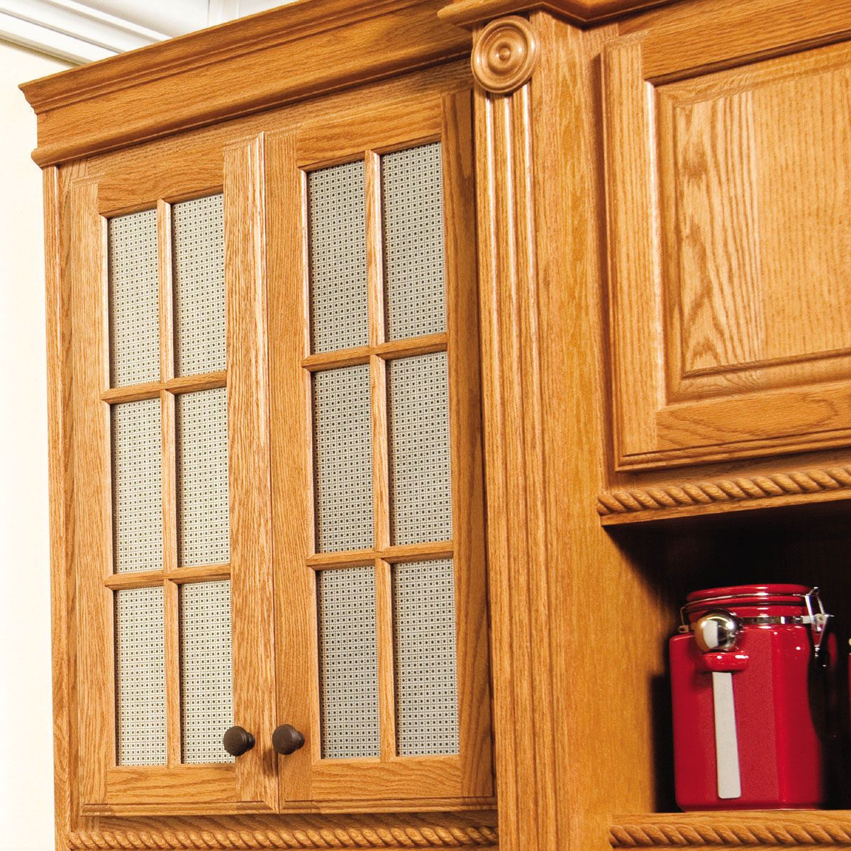 For a more stylish kitchen cabinet, cover the wood with ...