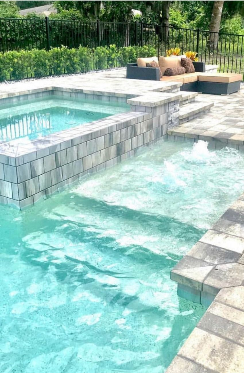 Looking for luxury pool ideas and spa options to create your dream swimming pool? Contact me to learn how you can live the outdoor life in Orlando!  #pools #outdoorspaces #realestate