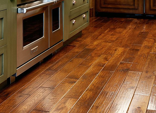 Rustic Hardwood Flooring This Hardwood Floor Is A Rustic Maple With A Warm Stain And Offers Maple Laminate Flooring Rustic Hardwood Floors Flooring