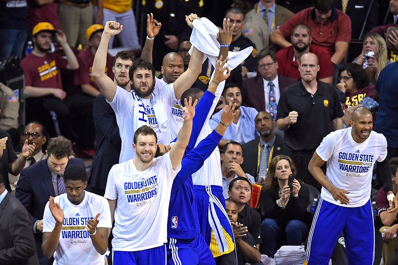 The Golden State Warriors bench erupts in cheers after a 3