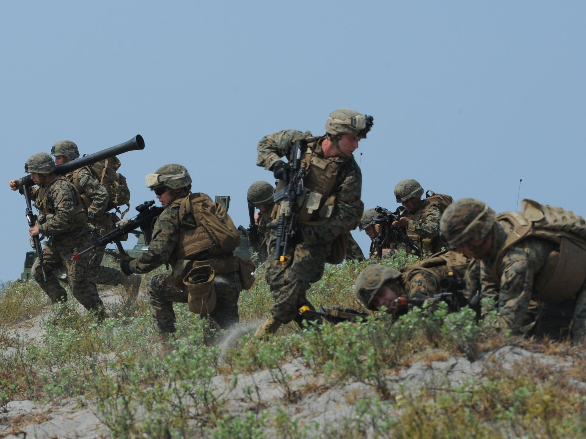 Marines run to their positions during an amphibious landing exercise on a beach at San Antonio in Zambales, Philippines, on April 21, 2015, as part of the annual Philippine-U.S. joint training.