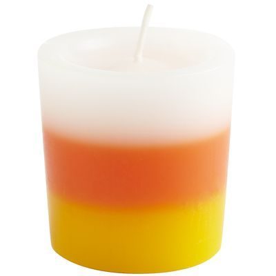 """Candy Corn Votive, $1.00 -- """"A votive with the scent of spun sugar and butterceam with a hint of burnt sugar fragrance."""""""
