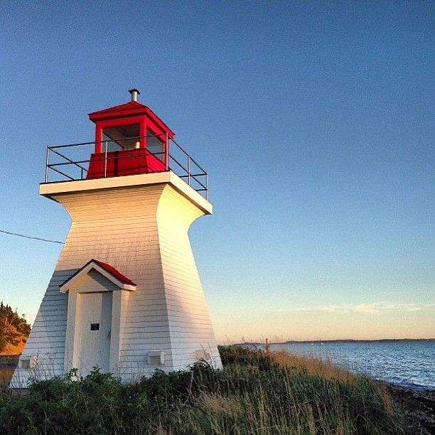 An evening kayak to the River Bourgeois lighthouse is our #VisitNovaScotia photo of the day. Thanks @sarahpo22!