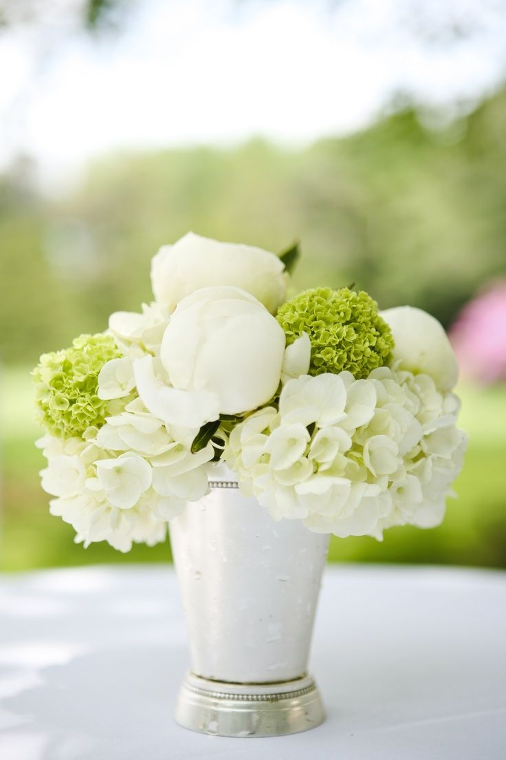 White and green peony and hydrangea arrangement in a julep cup by
