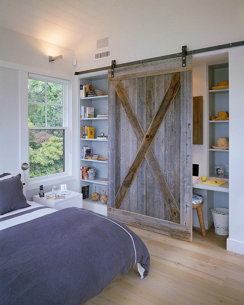 25 Bedrooms That Showcase The Beauty Of Sliding Barn Doors Barn Bedrooms Barn Door Designs Shelves In Bedroom