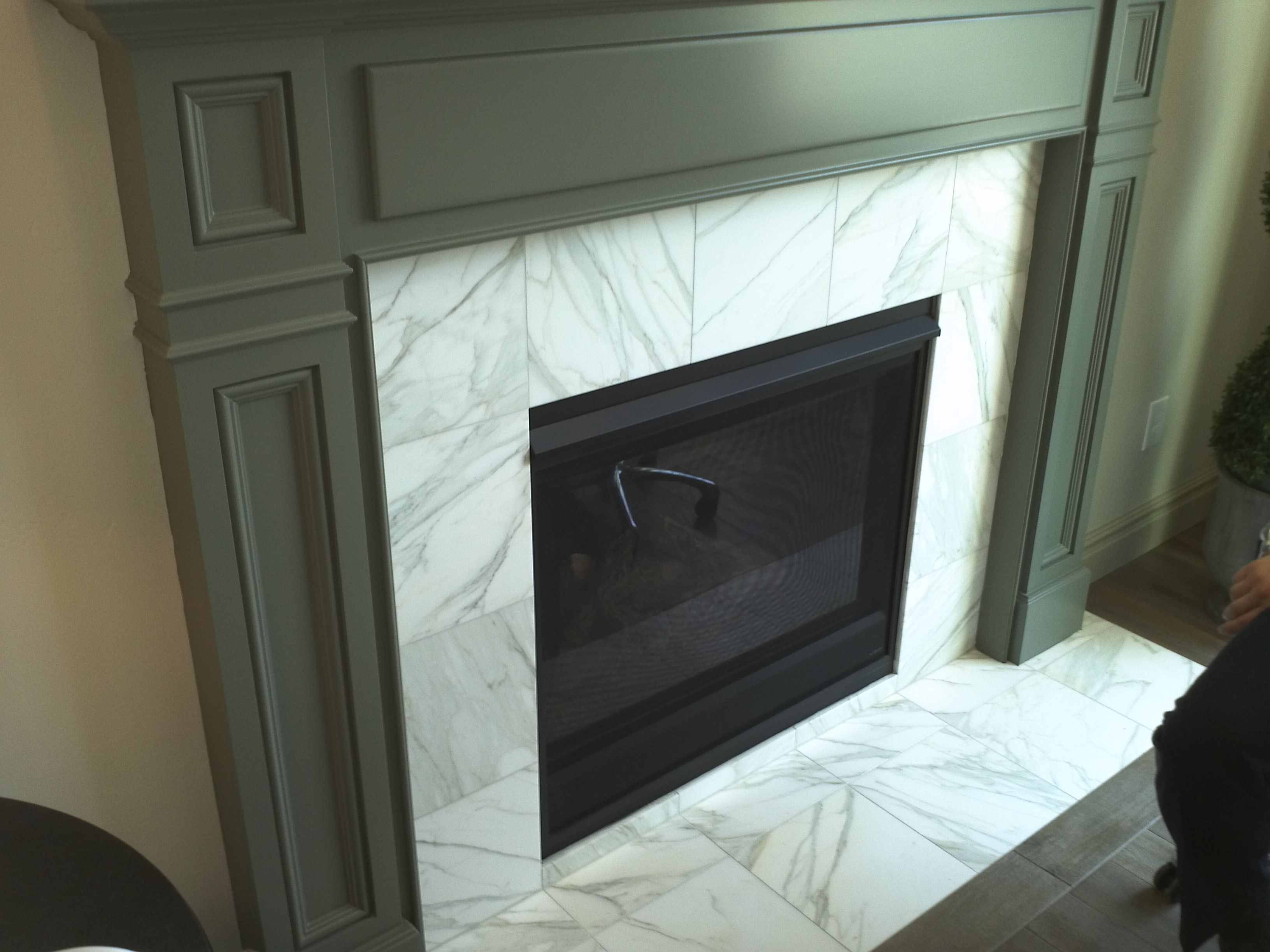 Carrara White Tile Fireplace Surround found at Contempo Tile