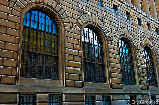 Windows in an old building's facade on Notre Dame street in Old Montreal Quebec Canada