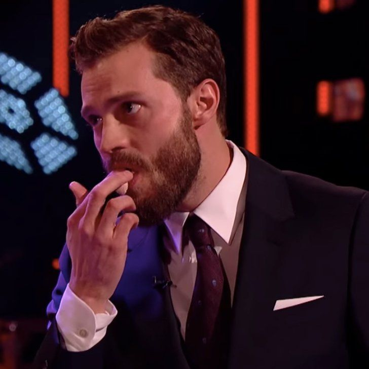 Pin for Later: Jamie Dornan Has No Choice but to Eat a Life-Size Christian Grey Cake