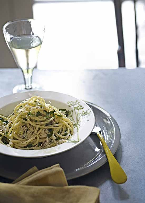 Lemon Spaghetti with crab: this is about as easy as pasta gets. 'Cooking' the sauce merely involves a little warming through to make an indulgent and bright supper in a few minutes. Recipes Alice Hart, styling Emma Thomas, photographs Emma Lee. http://www.hglivingbeautifully.com/2015/06/07/zest-for-life-3-recipes-celebrating-citrus-fruit/