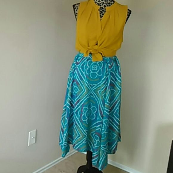 Earthbound skirt with free top Handkerchief skirt in PERFECT condition... perfect for spring and summer seasons. Teal with red, fuchsia, mustard and white patterns. Lightweight. Fully lined. 100% polyester with the look of silk Top: Collective Concepts... hidden button up top. 100% polyester. Mustard color FREE with skirt Earthbound Skirts Midi