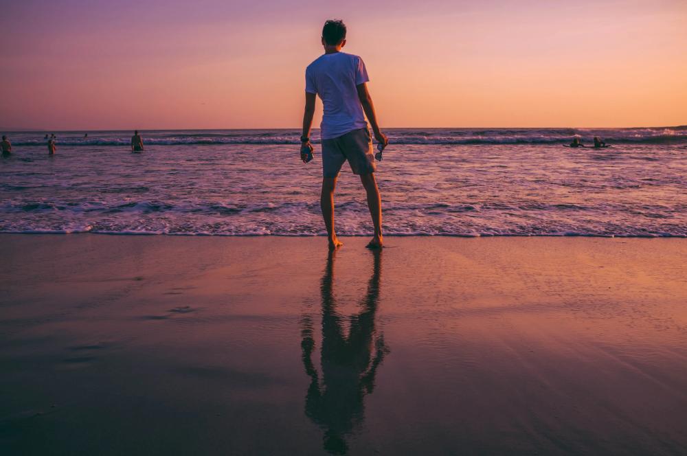 Man Standing In Front Of Seashore Photo Free Human Image On Unsplash Bali Tours Bali Photo
