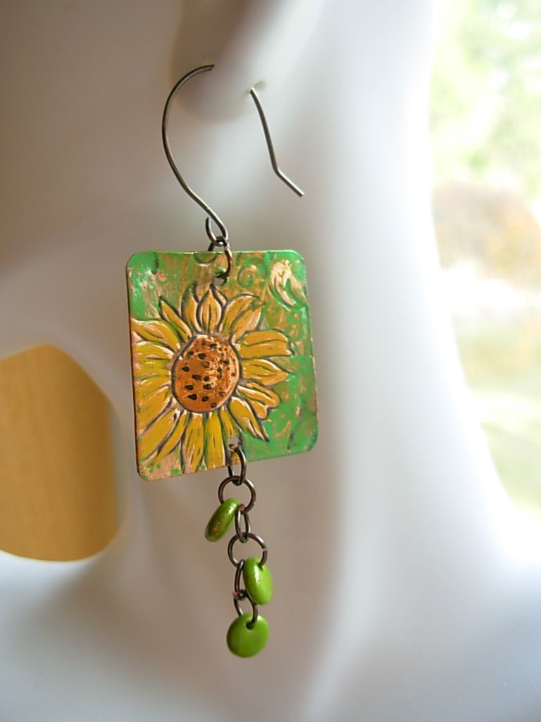Week 43.  Started as an embossed metal sheet which I then painted, punched and added a beaded chain to.