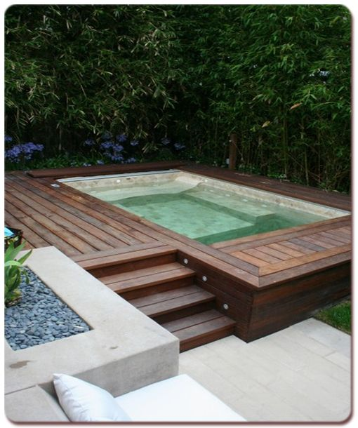 Lovely integration of an above ground spa into the for Above ground pool decks las vegas