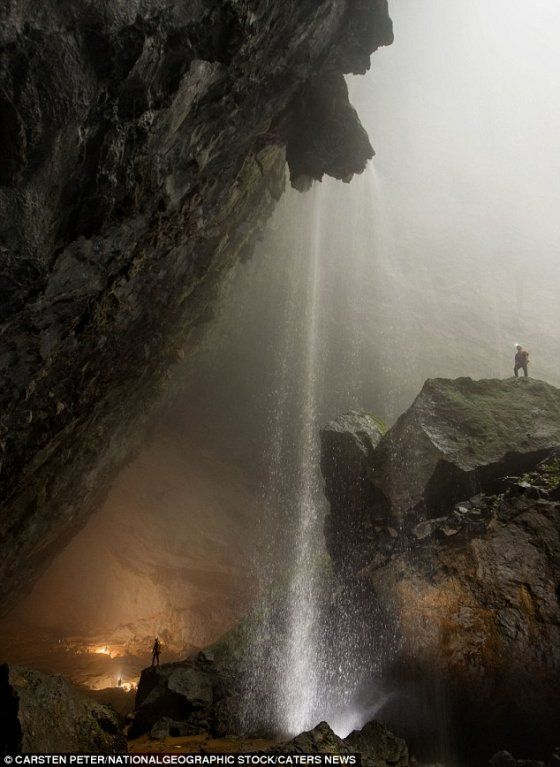 Wonderful waterfalls: A waterfall explodes into Hang Son Doong in the hidden depths of the Vietnamese jungle, which is part of a network of over 150 caves. Image credit: Peter Carsten