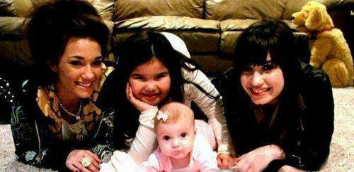 Demi Dallas and maddie with a baby