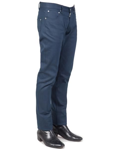 BILLY // DARK TEAL 17:  100% Cotton Denim jeans with a a low waist, roomy seat and thigh. The Billy has a tapered leg and just a hint of stretch built in. The high-quality raw denim, dyed-to-match stitching and chrome plated rivets give these jeans durability and a sleek look.