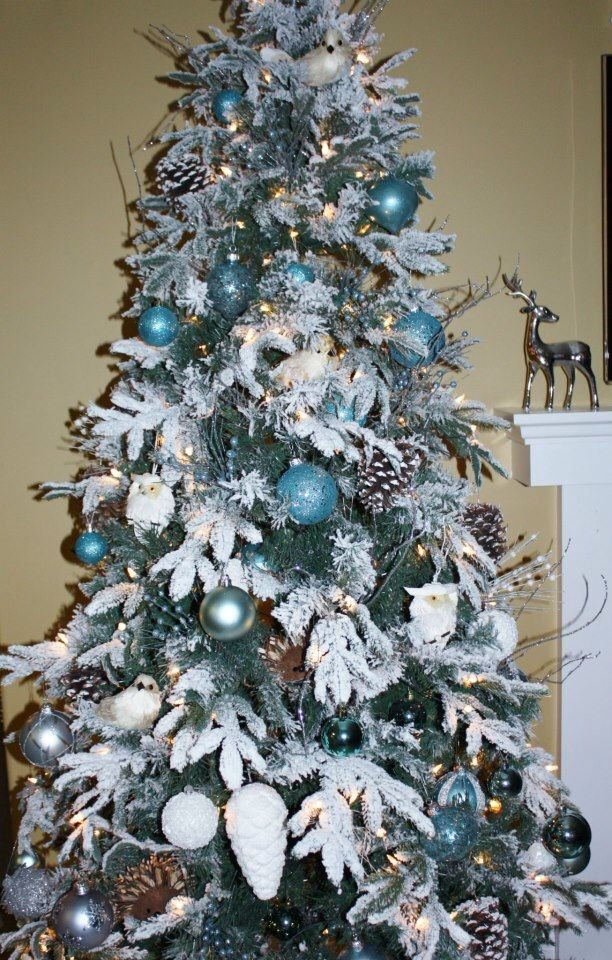 My Very Own Christmas Tree Woodland Animals In A Snow Laden Tree Accented With Turquoise And W Flocked Christmas Trees Christmas Tree Woodland Christmas Tree