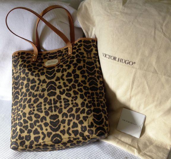 dce95581769 bolsa leopardo victor hugo - ombro victor hugo