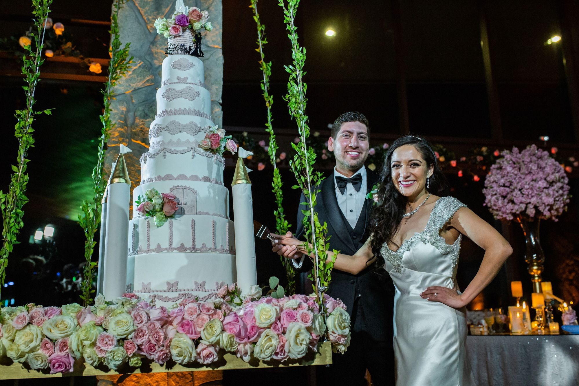 9 Tier Fairy Tale Themed Wedding Cake Hanging From The Ceiling At An At Home Reception In 2020 Disney Wedding Cake Disney Wedding Themed Wedding Cakes