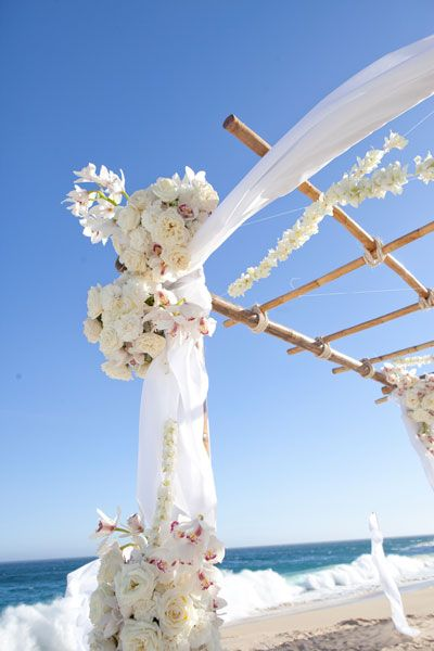 Beach-themed wedding, white and huppa look beautiful with a backdrop of blue sky and turquoise ocean! For destination weddings and beach weddings see www.destinationweddings.travel