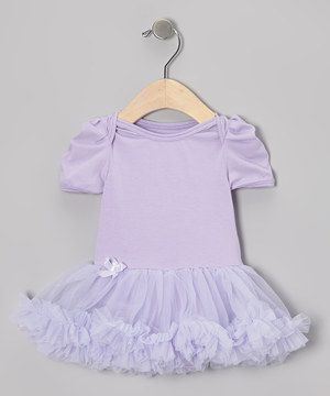 Ballerina meets baby in this girly bodysuit. Changing is quick and easy with its bottom snap closures and lap neck, while a rhinestone-studded bow adds the perfect final touch.