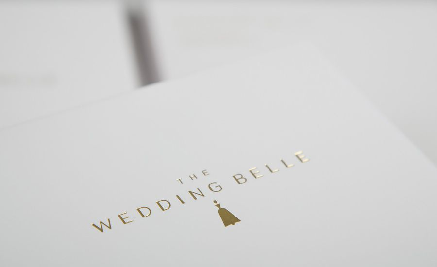 Logo and print with gold foil detail designed by Ghost for wedding planner The Wedding Belle.