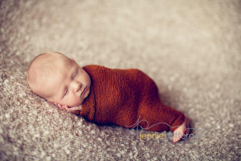 Newborn baby boy columbia spring hill tn nashville marathon prop ellie bellie design wrap pose head in