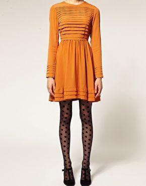 Love this little orange dress