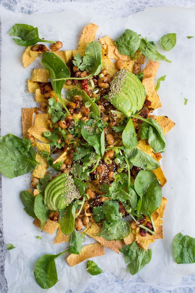 Loaded Vegan Nachos with Harissa Beans, the perfect easy snack for a hot summer's day.