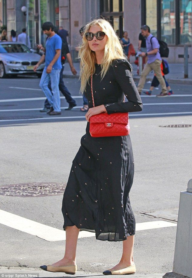 129898cd7595 Too cool for school  Elsa Hosk teamed the look with a red Chanel bag and  stylish shades.