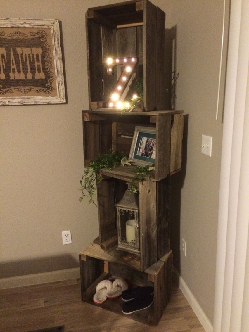 Rustic crate shelf unit with basketball, tennis shoes, nail polish ...