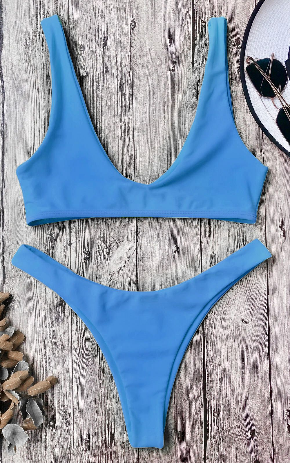 b5bf86d91bbcc A sleek solid scoop bathing suit features pullover style bralette bikini  crop top and high cut legs swim bottoms