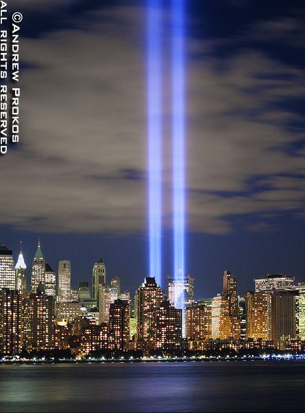 Panoramic Skyline Of Lower Manhattan At Night With Towers Of Light - Two beams light new yorks skyline beautiful tribute 911