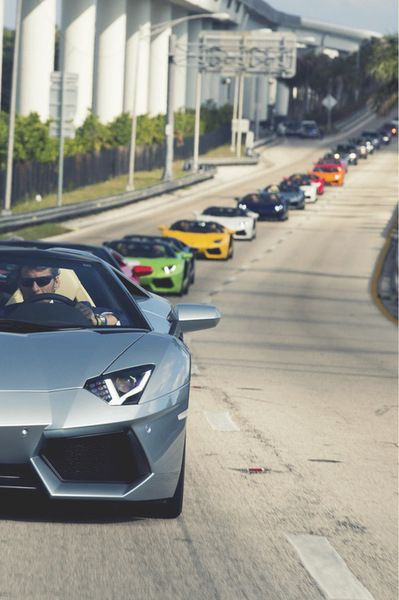 The Pictures Here Shows Some Lamborghinis On A Highway All Lined