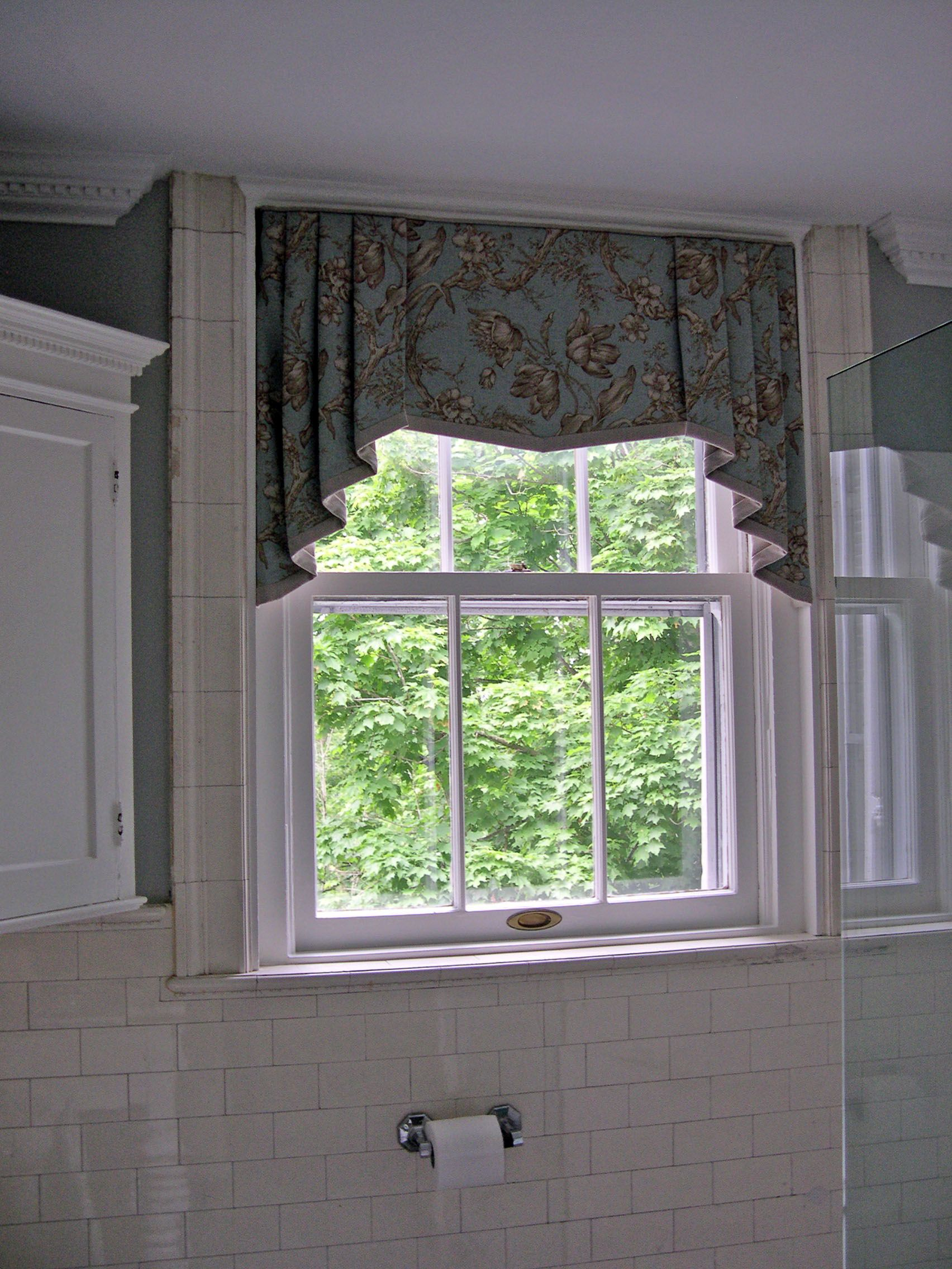 Shaped valance with banding and contrast lined jabots ...
