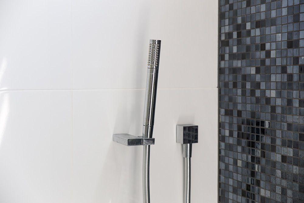 Black glass mosaic tiles and Kohler tapware and Clipsal saturn zen ...
