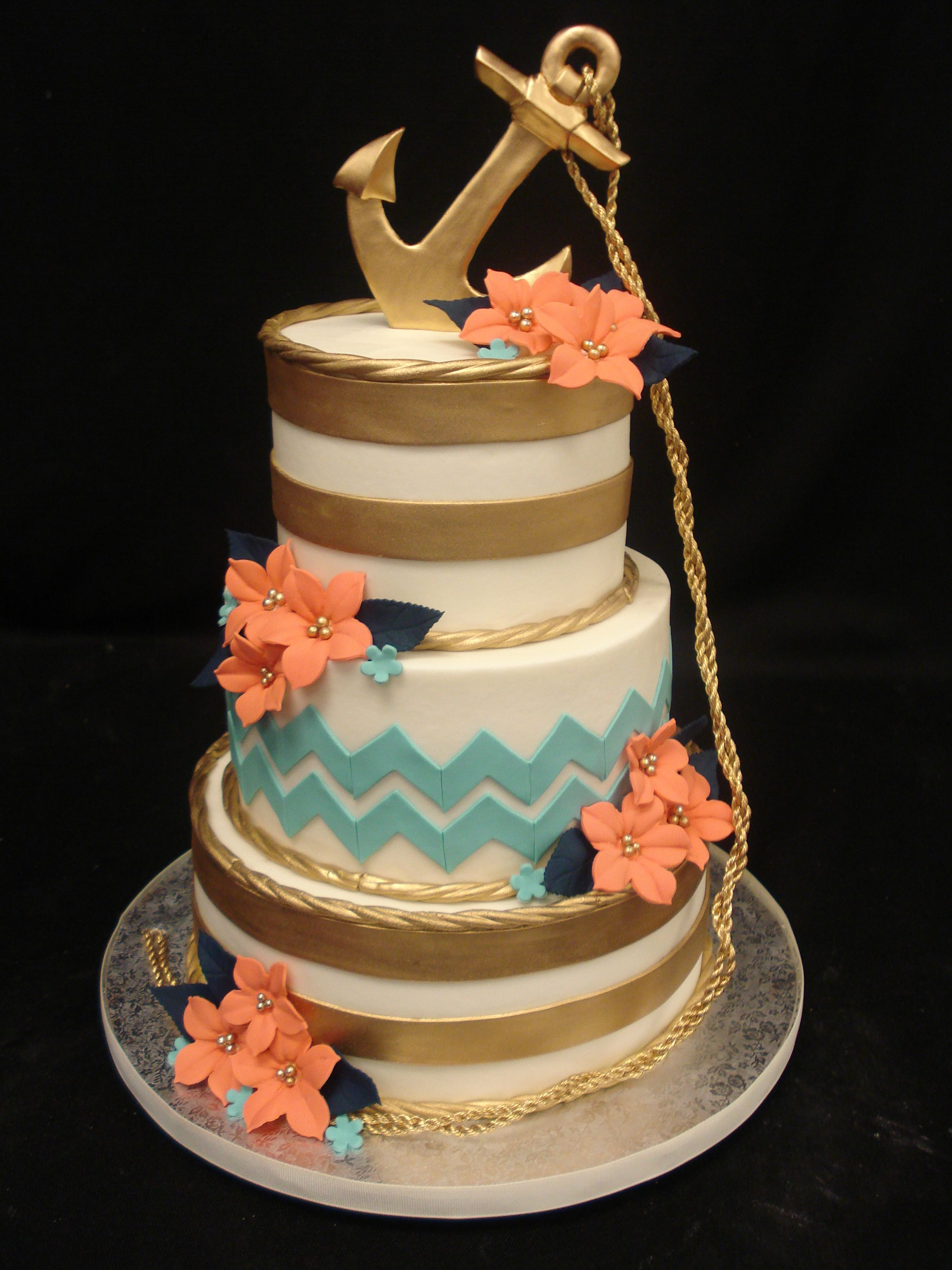 Gold bands aqua chevron and peach petunias adorn this party cake