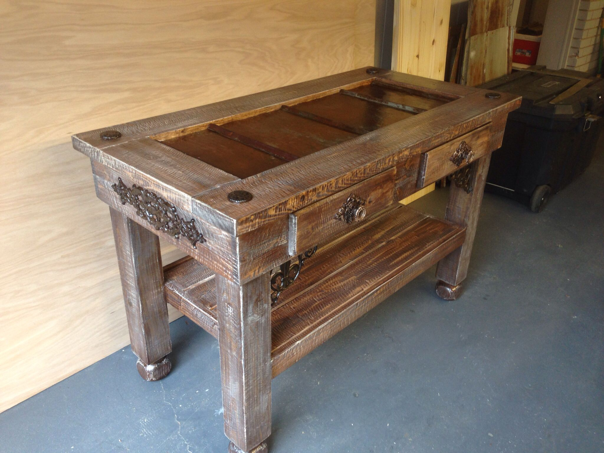 tin furniture. i build furniture out of old things that we find and create a unique look for example this is an entryway table built around barn tin
